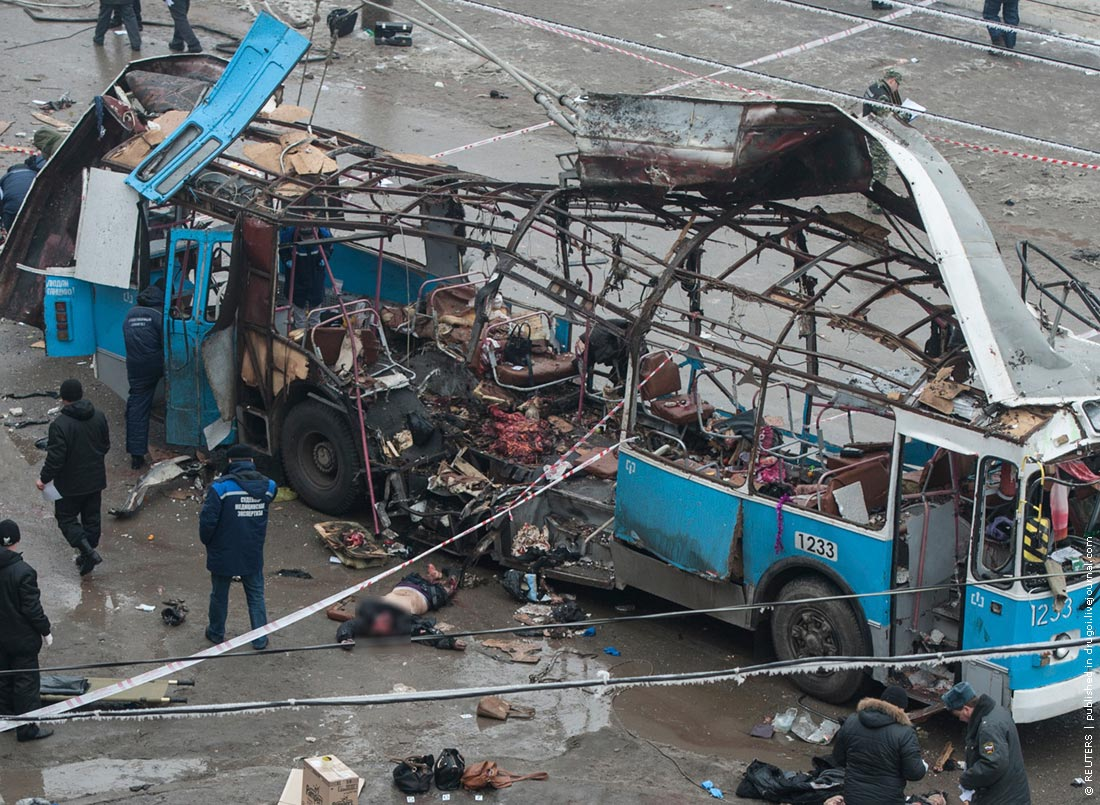 Investigators work at the site of a blast on a trolleybus in Volgograd