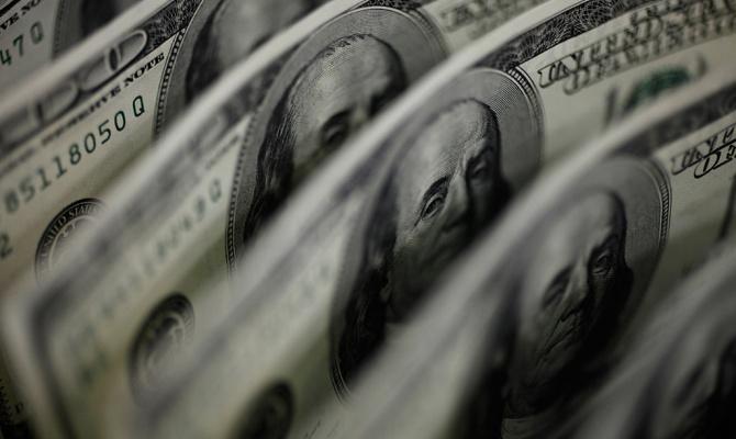 Рубль несет ожидаемые потери в предпоследние торги года