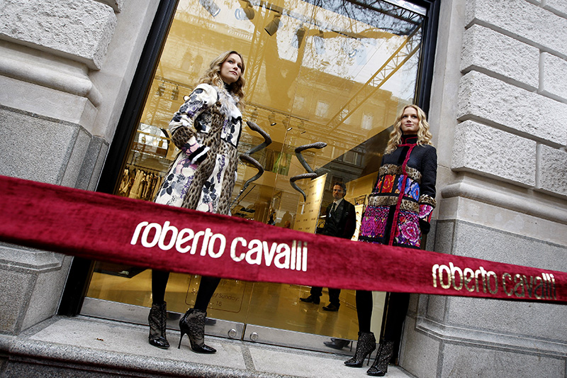 Models stand at the front of the door during the opening ceremony of Italian designer Roberto Cavalli's fashion house in Budapest