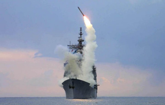 030323-N-6946M-001 ABOARD USS CAPE ST. GEORGE (CG 71) AT SEA -- A Tomahawk cruise missile launches from USS Cape St. George, operating in the eastern Mediterranean Sea in support of Operation Iraqi Freedom. (Photo by IS1 Kenneth Moll, USS Cape St. George) (Released by Sixth Fleet Public Affairs)