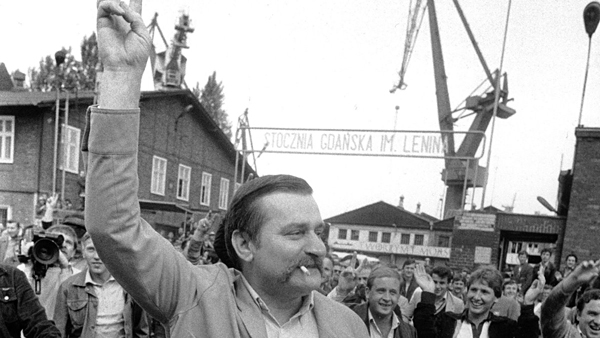 ** FILE ** Lech Walesa, leader of the former Solidarity Union, reacts to cheers by his fellow workers as he leaves the Lenin Shipyards in Gdansk, Poland in this June 17, 1983 file photo. The Solidarity movement 25 years ago when Walesa led a shipyard strike that would last 18 days, planted the seeds for the death of the communist regime nine years later, and foreshadow the collapse of the Soviet Union. The date on which the 1980 accord was signed was Aug. 31, 1980, and this year on Aug. 29-31, international figures will attend 25th anniversary ceremonies in Gdansk and Warsaw. (AP Photo/Langevin/File)