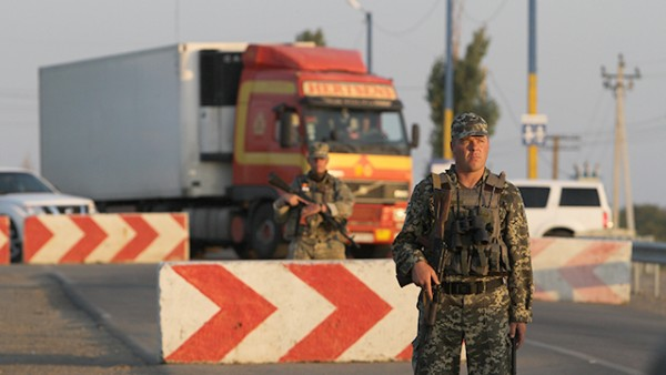 Sept. 20, 2015 - Ukraine - National guard soldiers handle the traffic on the Kalanchak BCP. Chairman of the Mejlis of the Crimean Tatar people Refat Chubarov initiated the transport blockade of the administrative border of the Kherson region and the Crimea from noon September 20 with the aim to cut off supplies of food and other products from the mainland to the annexed territory. Strategic goal: the returning of the Crimea under the control of the Ukrainian authorities. Mr. Chubarov does not rule out that after the ''food blockade'' of the annexed Crimea, the Crimean Tatars will seek an end to the supply of electricity to the peninsula. (Credit Image: В© Sergii Kharchenko/NurPhoto via ZUMA Press)