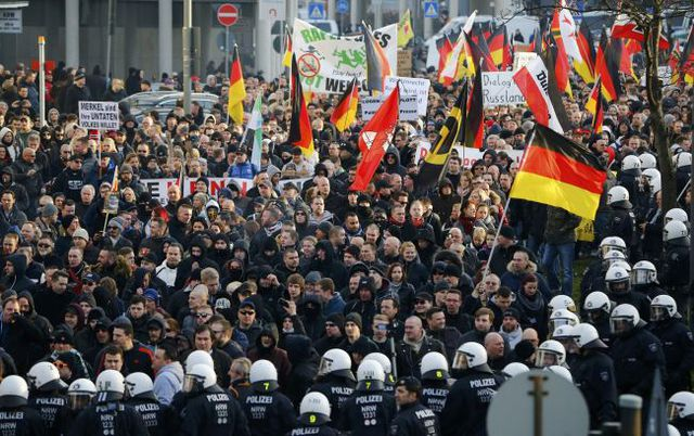 Supporters of anti-immigration right-wing movement PEGIDA (Patriotic Europeans Against the Islamisation of the West) take part in in demonstration march, in reaction to mass assaults on women on New Year's Eve, in Cologne, Germany, January 9, 2016.   REUTERS/Wolfgang Rattay