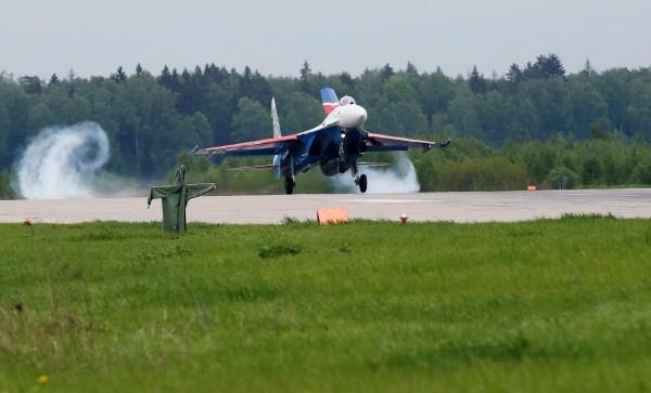 Sukhoi Su-27 jet fighter of Russkiye Vityazi aerobatic team lands at airfield of Kubinka air base outside Moscow