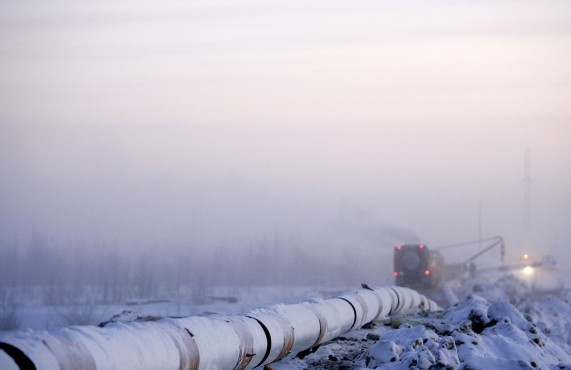A vehicle passed the Gazprom pipeline under construction in Novy Urengoy
