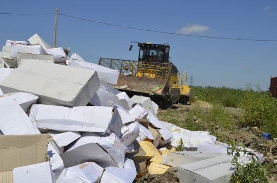 Handout photo of an employee operating a bulldozer while destroying illegally imported food falling under restrictions in Belgorod region
