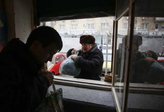 A man donates clothing to a volunteer centre in Kiev